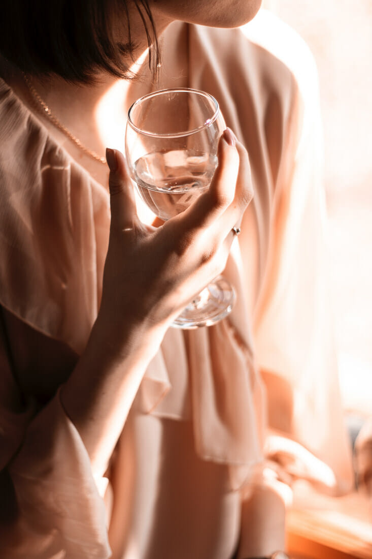 Woman holding glass and relaxing.