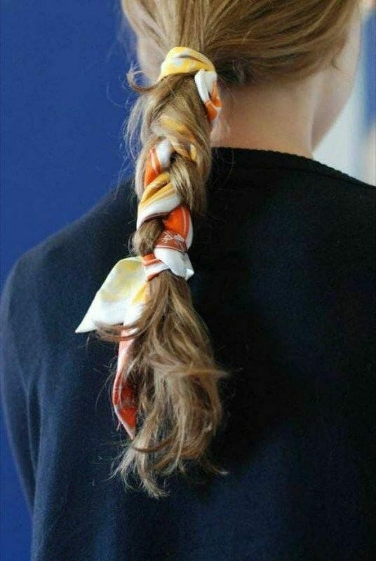 Head scarf bandana hairstyle in a braid.