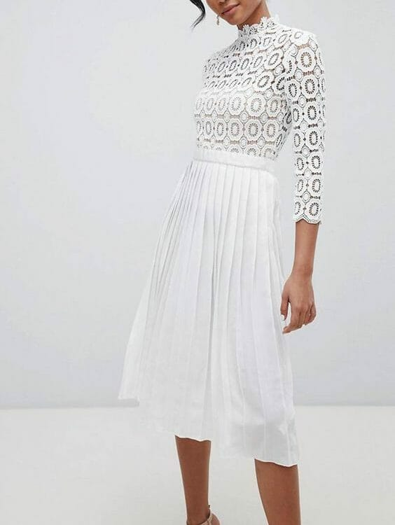 Upscale all white outfit worn by a woman