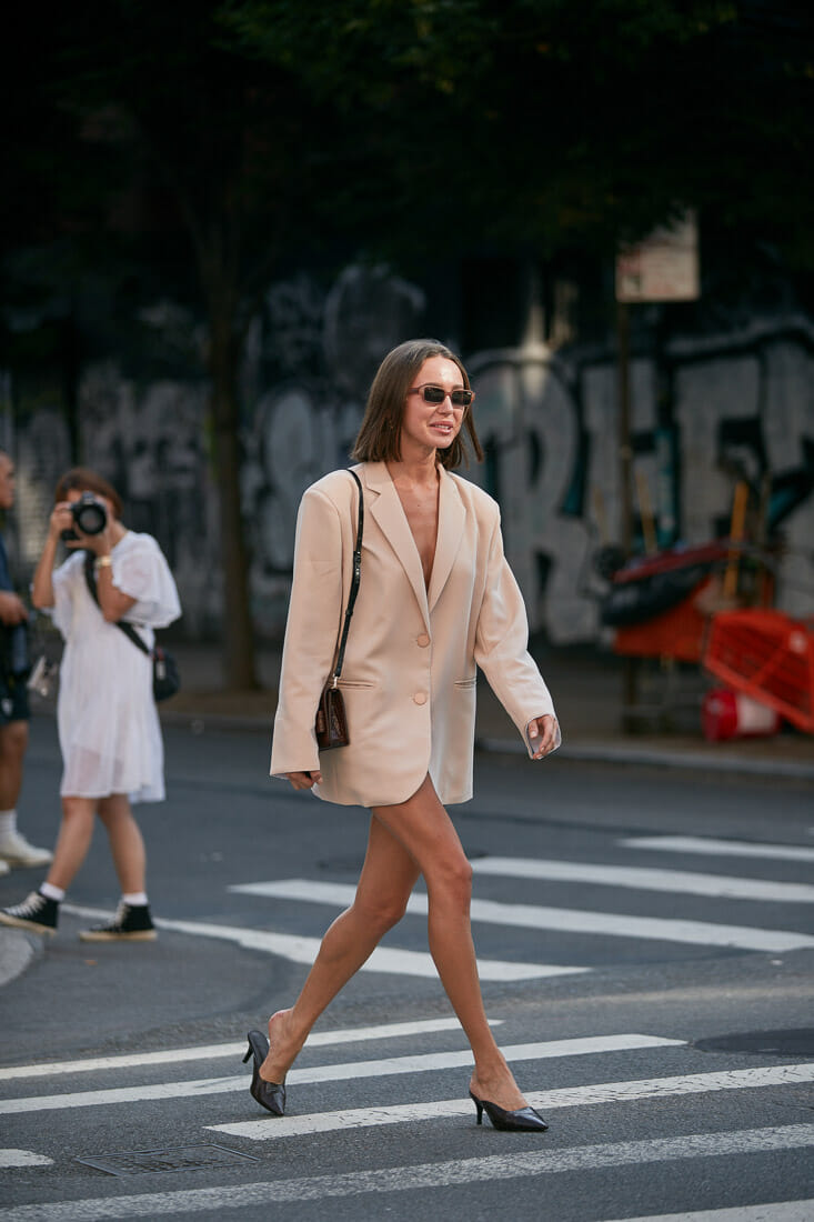 Beige oversized jacket on a woman.