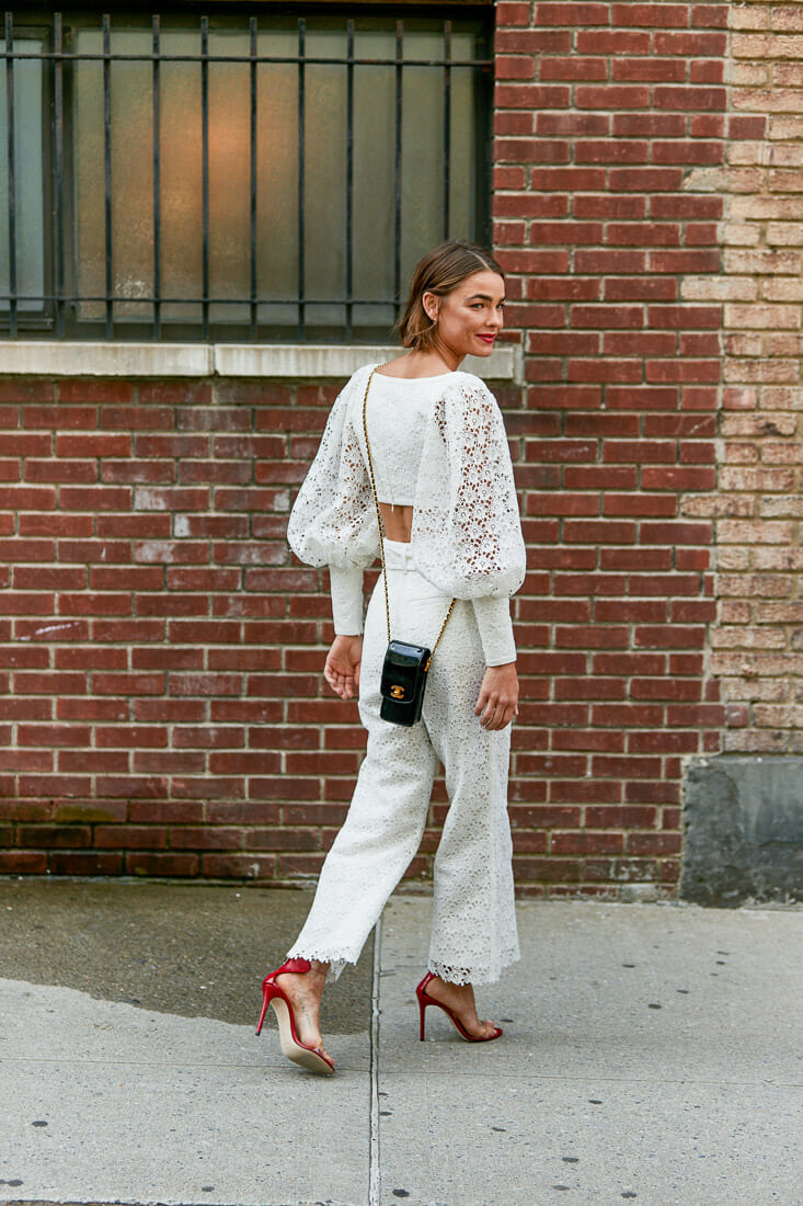 Puffy sleeves and a full white look.