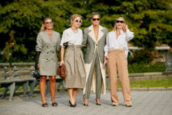 Neutrals wearing women gather for a shot.
