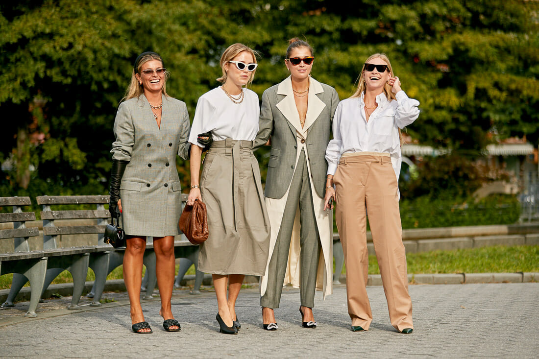 Neutrals wearing women gather for a shot.