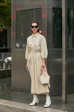Woman wears beige long dress.