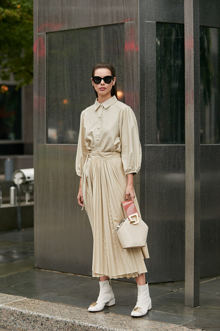 Woman wears beige long dress.