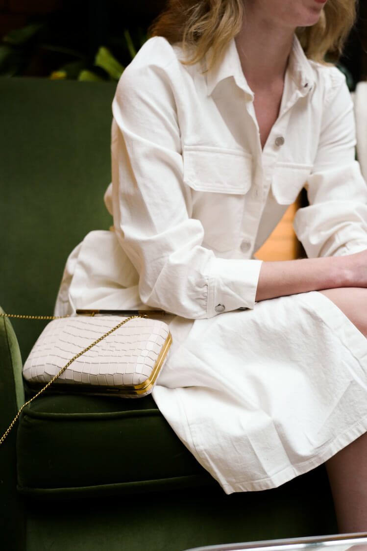 Vera Casagrande sports a white clutch by etienne aigner.