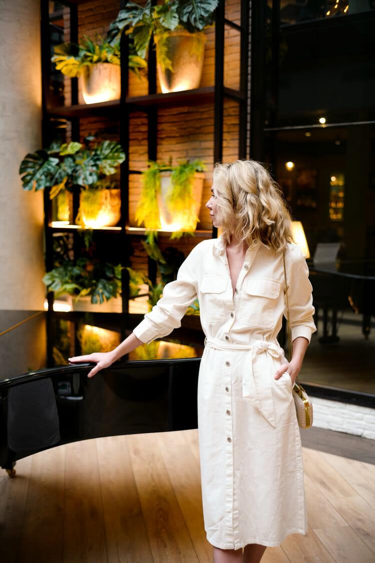 Vera Casagrande models a white denim dress in a hotel in Barcelona, Spain.