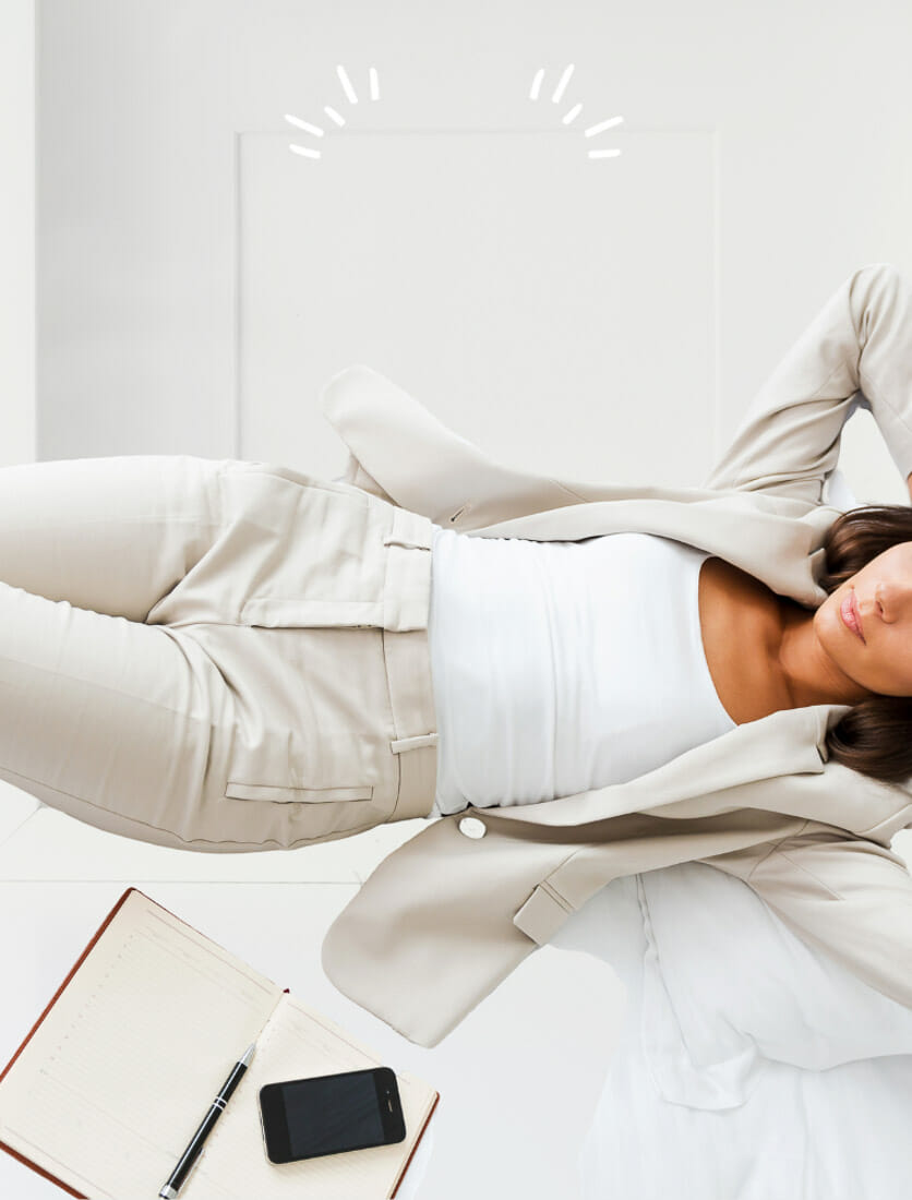 Woman wearing professional clothing relaxes.