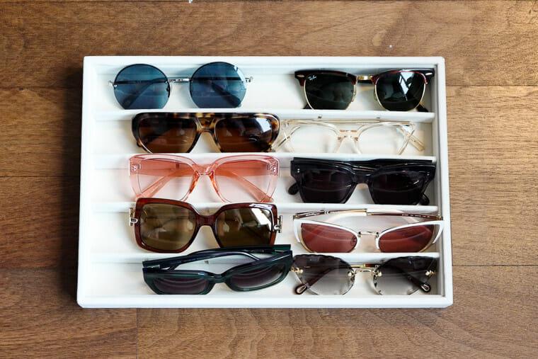 Organize sunglasses using these cute trays.