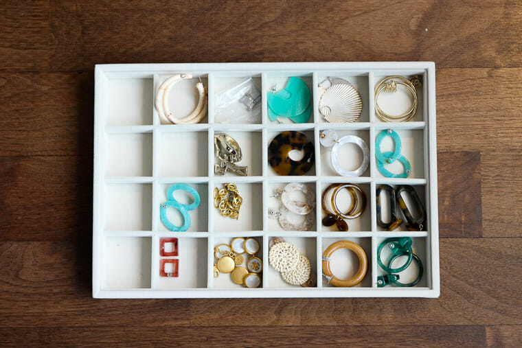 How to organize earrings in drawers using accessories trays.